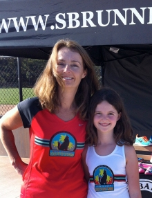 Photo of Coach Becky Aaronson of Kids Corner Coyotes with daughter Olivia