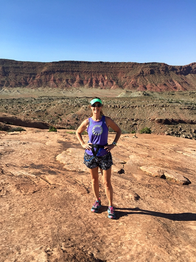 Photo of Becky Aaronson running on the trail to Delicate Arch