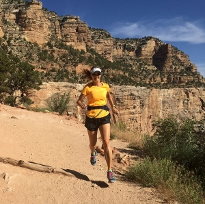 Photo of Becky Aaronson running down Bright Angel Trail in the Grand Canyon