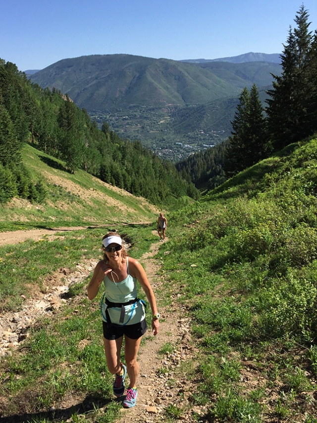 Photo of Becky Aaronson hiking up Aspen Mt.