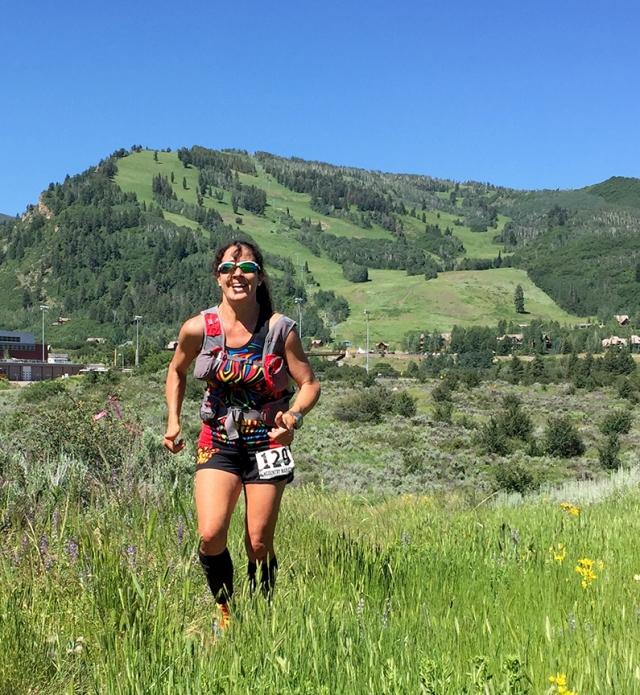 Photo of Laura Buitron runing the Aspen Backcountry Marathon