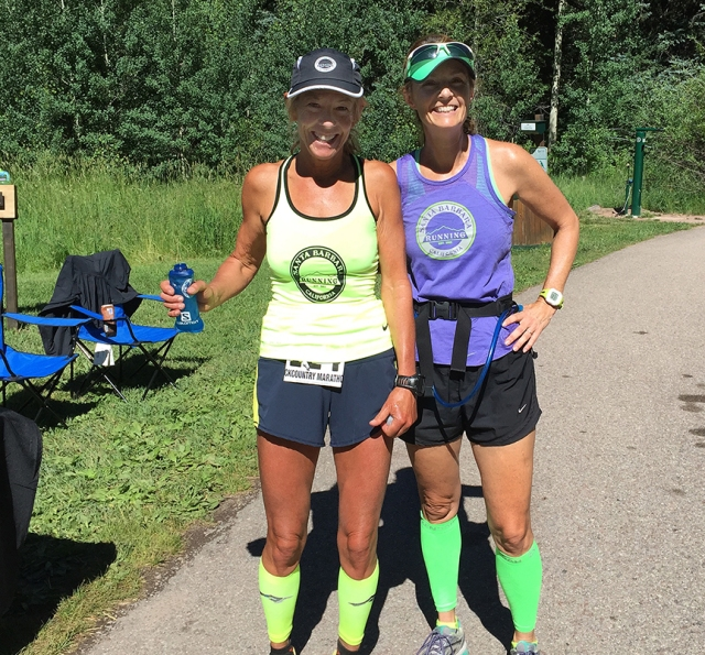 Photo of Patty Bryant and Becky Aaronson at an Aid Station during the Aspen Backcountry Marathon