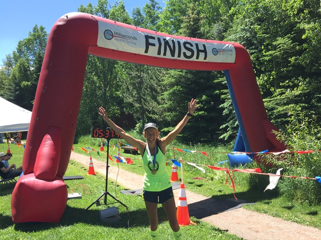 Photo of Patty Bryant at the finish line of the Aspen Backcountry Marathon
