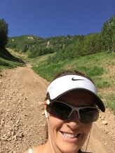 Photo of Becky Aaronson hiking Aspen Mt.