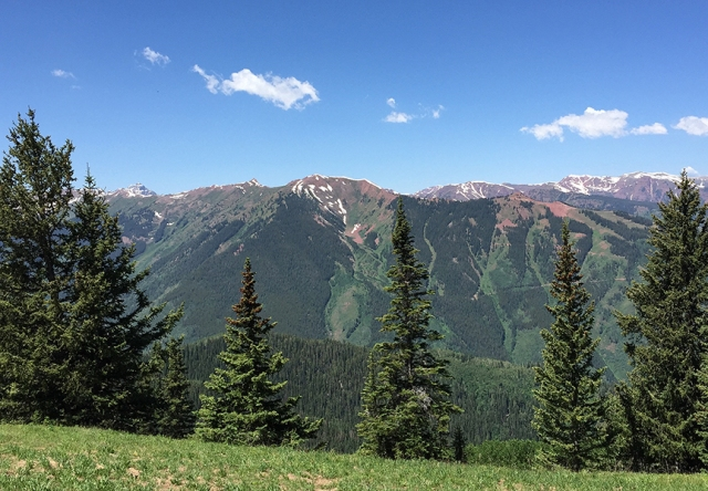 Photo of the top of Aspen Mountain during yoga class